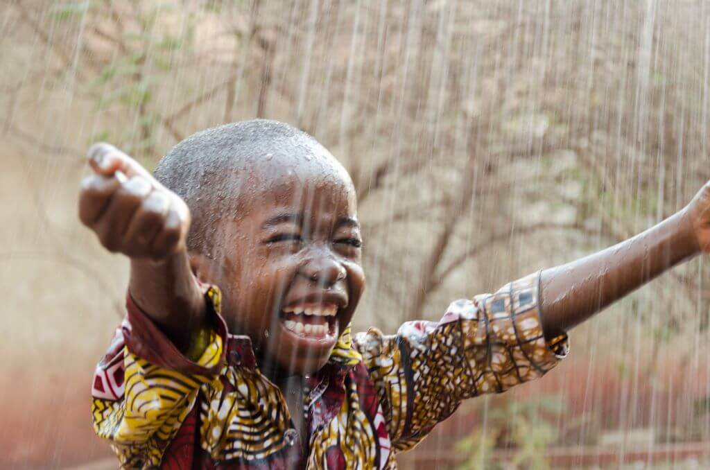 Boy with free flowing water beneficiary of money raised by fundraising copywriter