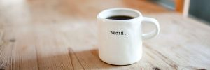 Where to start with website copywriting: Depicted by mug with slogan begin
